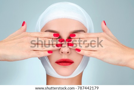 Beauty, Fashion and Plastic Surgery concept. Woman covering eyes with bandaged head Stock photo © flisakd