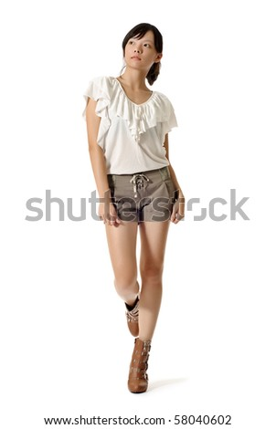 full length photo of young pretty chinese woman in black tshirt stock photo © deandrobot