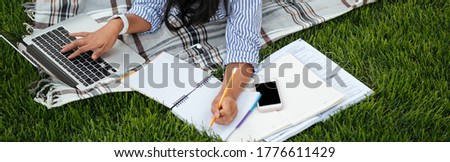 Top view of pretty asian student, keeping records in paper noteb Stock photo © deandrobot