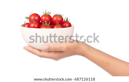 Stock photo: Hand holding branch of cherry tomatoes isolated on white background