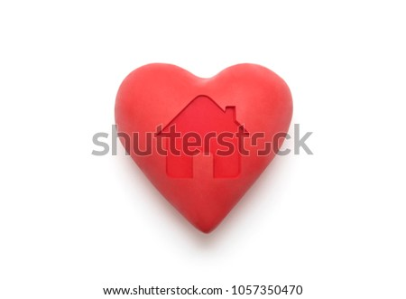 Red heart with imprinted house shape over white background with clipping path  Stock photo © sqback