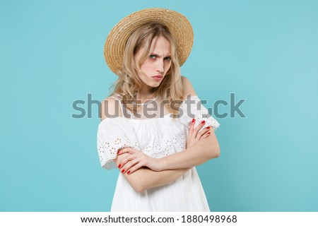 Image of Confused displeased blonde woman in dress looking up Stock photo © deandrobot