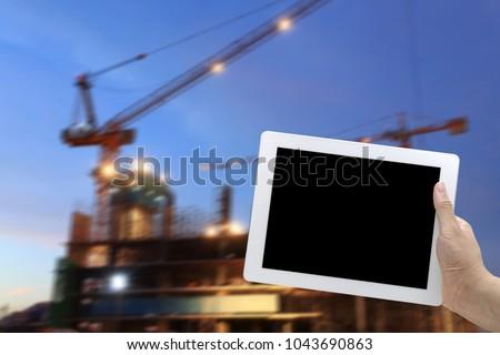 手 ホールド デジタル タブレット 建設現場 夕暮れ ストックフォト © vichie81