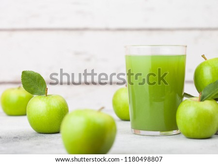 Glass of fresh organic apple juice with granny smith and british bramley apples on wooden background stock photo © DenisMArt