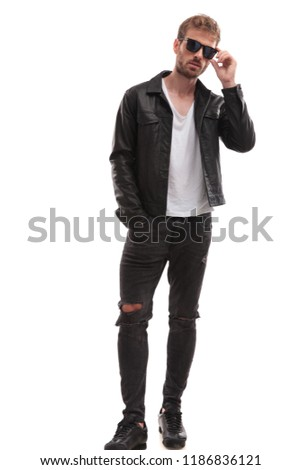 relaxed casual man wearing black leather jacket fixes sunglasses Stock photo © feedough
