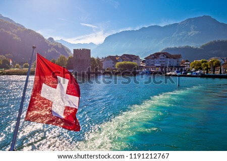 Lake Luzern boat flowing from Stansstad village with Swiss flag Stock photo © xbrchx