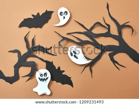 Paper tree branches flying ghosts and bats on a brown background with space for text. Scary handcraf Stock photo © artjazz