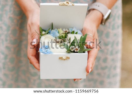 beautiful wedding rings in a wooden box on an old family book stock photo © ruslanshramko