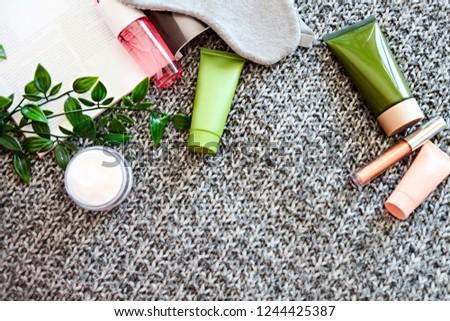 SPA cosmetic products on dark blanket from above. Fashion magazi Stock photo © dashapetrenko