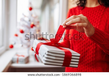 Young woman receiving a surprise gift red box from her boyfriend on sofa Stock photo © ruslanshramko