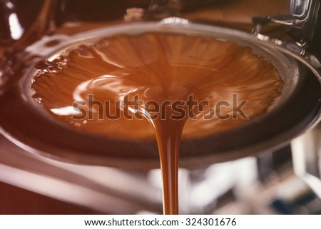 Macro photo of a coffee machine with drops of drink and a cup of freshly made coffee. Espresso Brewi Stock photo © artjazz