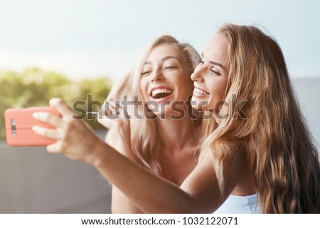 Image of european blond woman smiling and taking selfie photo on Stock photo © deandrobot
