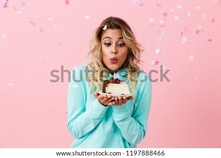 Photo of excited woman in basic clothing holding piece of birthd Stock photo © deandrobot