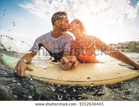 Couple in love having romantic tender moments at sunset on the beach Stock photo © Lopolo