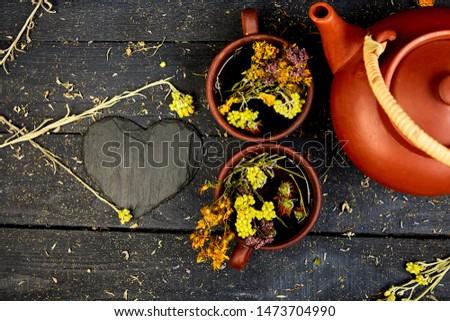 Cup of herbal tea - tutsan, sagebrush, oregano, helichrysum, lavender Stock photo © Illia