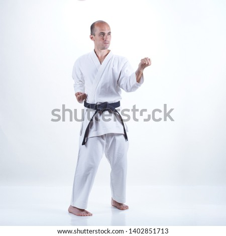 Fiatal atléta vonatok hivatalos karate fekete Stock fotó © Andreyfire