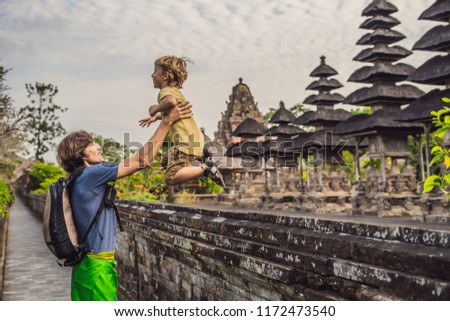 Dad and son tourists in Traditional balinese hindu Temple Taman Ayun in Mengwi. Bali, Indonesia Trav Stock photo © galitskaya