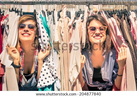 Young beautiful women at the weekly cloth market - Best friends sharing free time having fun and sho Stock photo © studiolucky