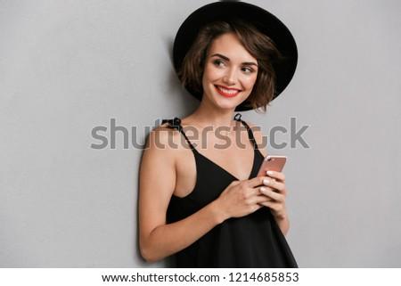 glimlachend · vrouw · glimlachen · vrouw · zwarte · jurk · geïsoleerd - stockfoto © deandrobot