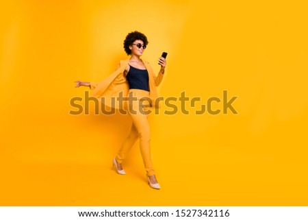Full length photo of stylish afro american woman wearing green d Stock photo © deandrobot