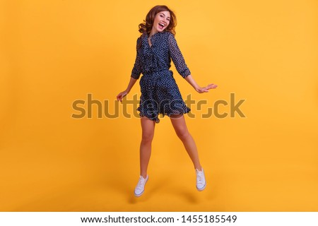 Full length photo of charming woman in dress rejoicing and holdi Stock photo © deandrobot