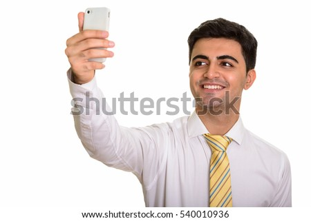 portrait of handsome man 20s taking selfie on mobile phone whil stock photo © deandrobot