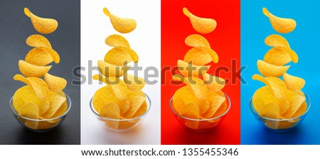 Glass bowl plate with potato crisps chips with paprika and chilli peppers on black stone table backg Stock photo © DenisMArt