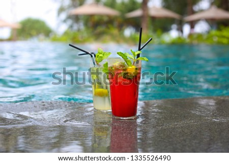 Classical and Strawberry Mojito cocktail at the edge of a resort Stock photo © dashapetrenko