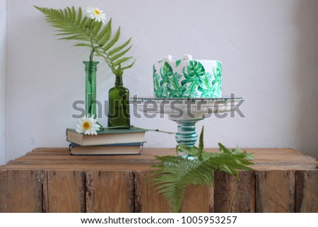 Holiday cake with monstera leaves design. Tropical birthday part Stock photo © dashapetrenko