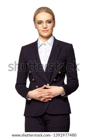 Pretty blonde woman in business outfit stands with folded hands Stock photo © filipw