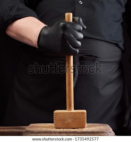 vintage meat hammer on vintage chopping board and black stone table background butcher utensils sp stock photo © denismart
