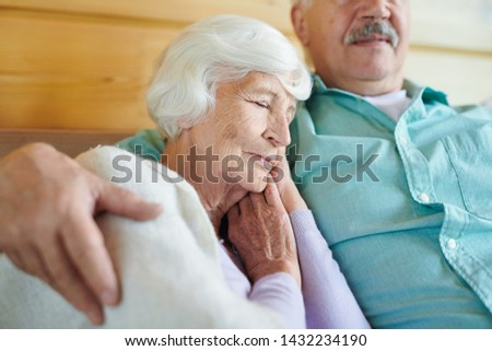 gracious granny with white hair napping on shoulder of her spouse stock photo © pressmaster