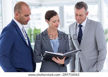 Mature well-dressed businesswoman explaining points of her report Stock photo © pressmaster