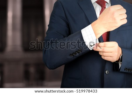 business man in blue suit standing on a concrete wall background Stock photo © Freedomz