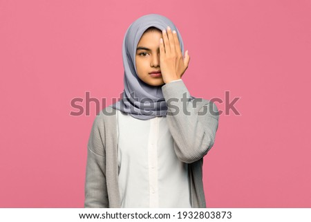 Young muslim female with hijab hiding her face and casualwear Stock photo © pressmaster