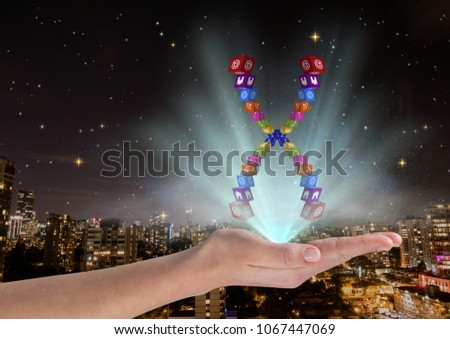 hand with application icons chromosome over and with blue lights in front of blurred city at night stock photo © wavebreak_media