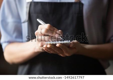 Kadın garson sipariş notepad mutfak otel Stok fotoğraf © wavebreak_media