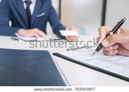 interviewer or board reading a resume during job interview empl stock photo © freedomz