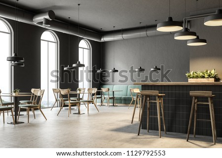 Interior of luxurious restaurant with wooden walls and sophisticated chandeliers Stock photo © pressmaster