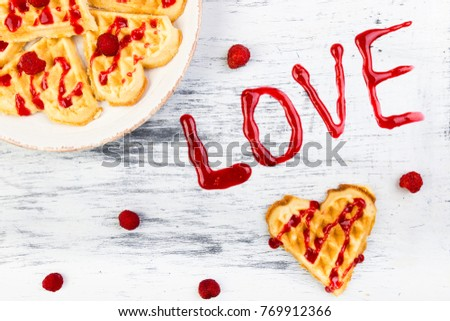 Belgian heart shaped waffle on white background. Word love made by jam. Stock photo © Illia