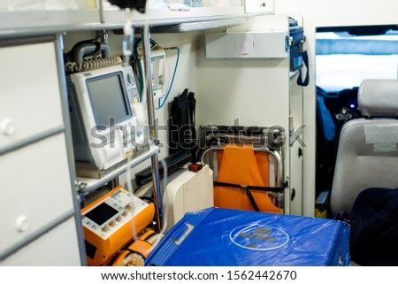 Stretcher by first aid medical equipment and other stuff inside ambulance car Stock photo © pressmaster