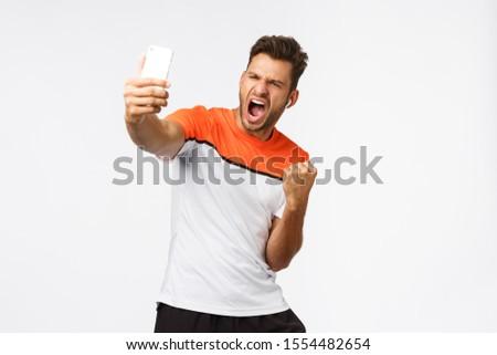 удовлетворенный красивый мужчины спортсмена спортивных футболки Сток-фото © benzoix