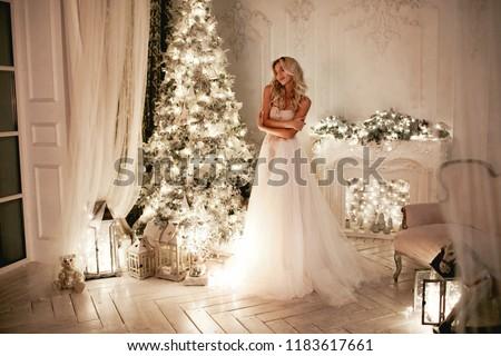 Frau lange rosa Hochzeitskleid Weihnachten dekoriert Stock foto © ElenaBatkova
