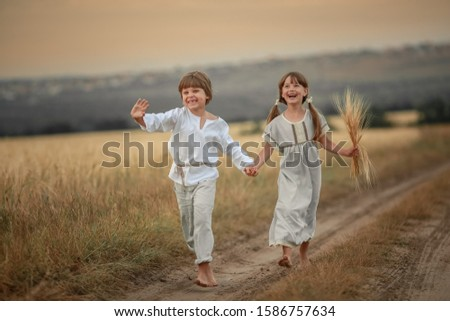 Brother and sister village children running barefoot on a rural road Stock photo © ElenaBatkova