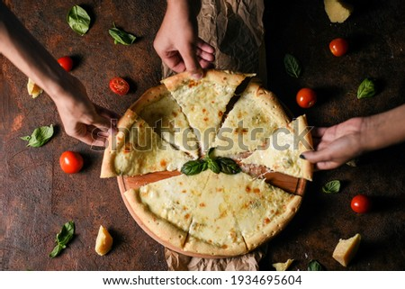 Classic salami slices with basil and pepper on wooden chopping board and light kitchen table backgro Stock photo © DenisMArt