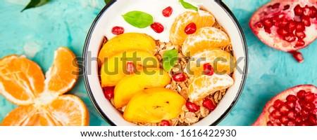 Banner of Tropical fruit Breakfast homemade granola yogurt. Healthy Stock photo © Illia