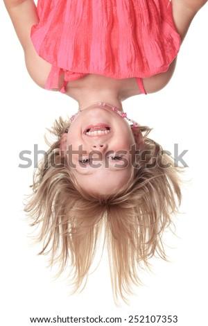 Piccolo bella ragazza rosa vestiti sottosopra isolato Foto d'archivio © Lopolo