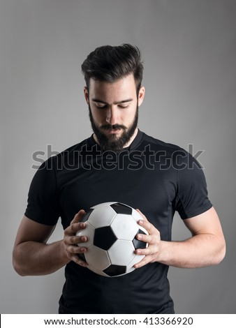 Young serious-looking and motivated sportsman hold hand on heart and standing as hear national anthe Stock photo © benzoix