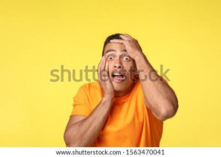 Scared, stunned and speechless frightened handsome man, grab head gasping, open mouth and stare away Stock photo © benzoix