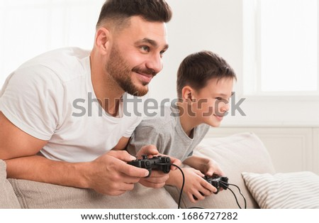 Stay at home. Gamer playing at home. Coronavirus isolation mode. Stock photo © popaukropa